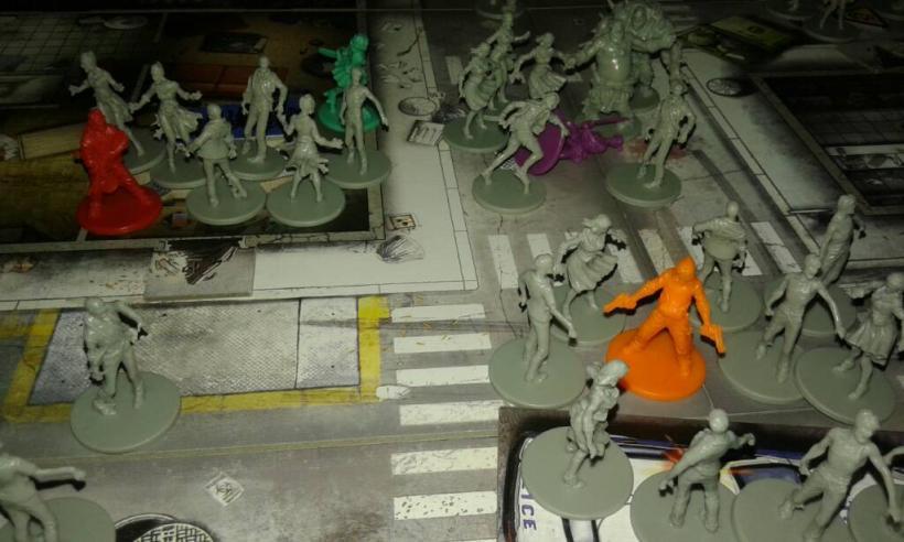 Zombicide: sopravvissuto accerchiato dagli zombi